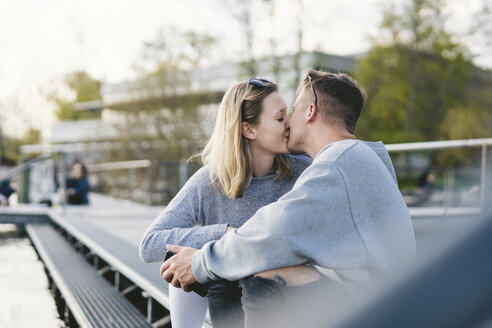 Young couple kissing on jetty at Lake Zurich, Zurich, Switzerland - FBAF00650