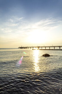 View to sea bridge at sunset, Kuehlungsborn, Germany - PUF01594