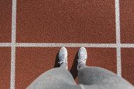 Closeup of sportswoman feet on racetrack - AHSF00463