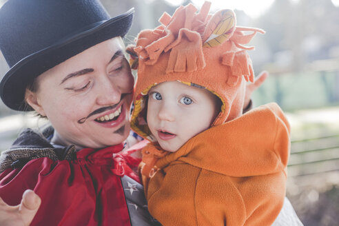 Portrait of mother and little son dressed up for carnival - IHF00084