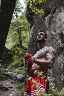 Tattooed boxer standing in nature - LJF00073