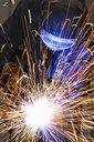 Close up of welder using welding saw - JUIF01054