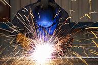 Welder using welding saw - JUIF01096