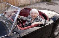 Smiling older woman driving convertible - BLEF05770