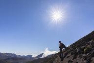 Tourist enjoying view from Sliding Sands Trail, Haleakala volcano, Haleakala National Park, Maui, Hawaii, USA - FOF10796