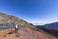 Tourist enjoying view from Sliding Sands Trail, Haleakala volcano, Haleakala National Park, Maui, Hawaii, USA - FOF10805