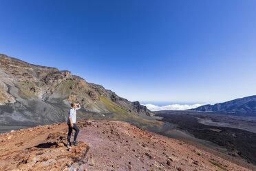 Tourist enjoying view from Sliding Sands Trail, Haleakala volcano, Haleakala National Park, Maui, Hawaii, USA - FOF10805