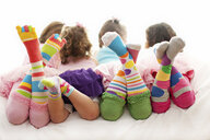Rear view of girls wearing colorful socks - BLEF06409