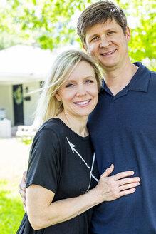 Caucasian couple hugging in backyard - BLEF06451