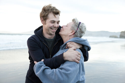 Caucasian mother and son hugging on beach - BLEF06484