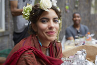 Close up of smiling woman wearing flowers and shawl - BLEF06604