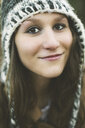 Close up of smiling Caucasian woman wearing knitted hat - BLEF06625