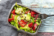 Strawberry avocado salad with feta, rocket, pine nuts and cress in lunch box - SARF04296