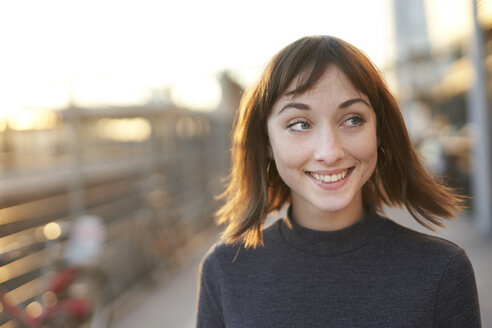 Portrait of smiling young woman at evening twilight - PNEF01569