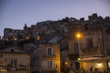 View from Ragusa Ibla to Ragusa Superiore at dusk, Ragusa, Sicily, Italy - MAMF00765