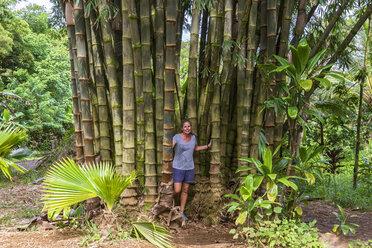 Female tourist standing between Bamboo, Maui, Hawaii, USA - FOF10834