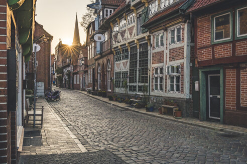 Half-timbered houses at an alley at sunset, Lauenburg, Schleswig-Holstein, Germany - KEBF01255