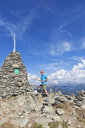 Hiker at viewpoint with cairn, Lammersdorf Mountain, Nock Mountains, Carinthia, Austria - GWF06088