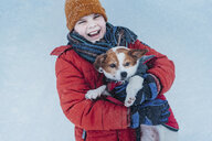 Portrait of laughing boy and his dog in winter - MJF02357