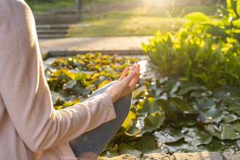 Young woman meditationg in a park, mudra - AFVF03183