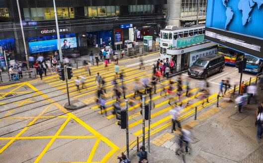 Pedestrians crossing road in Hong Kong Central, Hong Kong, China - HSI00666