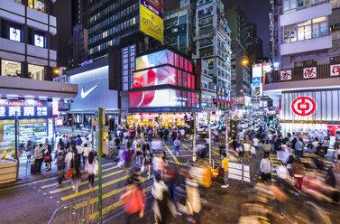 Pedestrians crossing road at night, Mong Kok, Hong Kong, China - HSIF00696