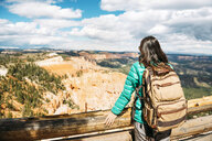 Women hiker with backpack on a lookout in Bryce Canyon, Utah, USA - GEMF02975