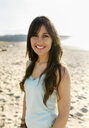 Portrait of a smiling young woman on the beach - MGOF04098