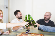 Colleagues having pizza and beer in office - FMOF00680
