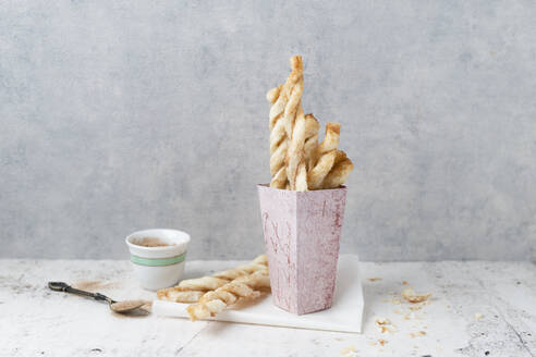 Paperbag of puff pastry sticks with sugar and cinnamon - MYF02111