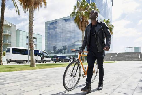 Man with bike - JND00059