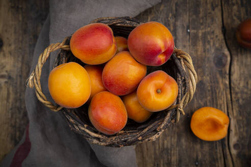 Apricots in basket on dark wood - LVF08080