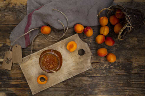 Apricot jam and apricots on dark wood - LVF08083