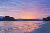 Boats sailing in bay at sunrise, Bay of Islands, Paihia, New Zealand - MINF11615