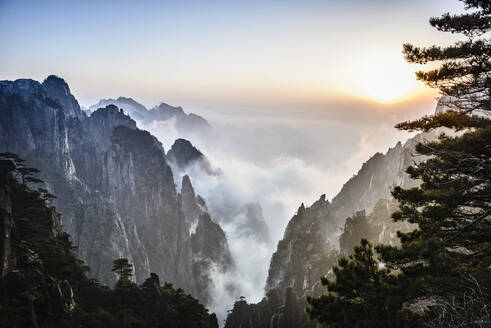 Fog rolling over rocky mountains, Huangshan, Anhui, China - MINF11693