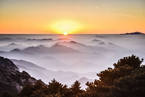 Fog rolling over rocky mountains, Huangshan, Anhui, China - MINF11699