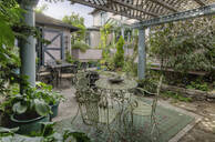Tables and chairs on patio garden - MINF11921