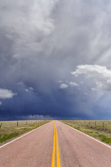 Storm clouds over open road, Rush, Colorado, United States - MINF11936