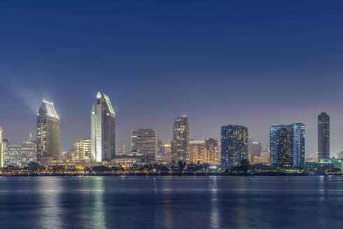 City skyline lit up at night, San Diego, California, United States - MINF11978