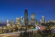 City skyline lit up at night, Seattle, Washington, United States - MINF11987