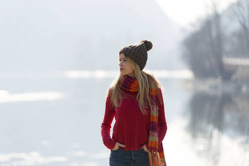 Young blond woman at a lake in winter - JSRF00205