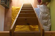 Wooden ladder, bed in bedroom - JPTF00145