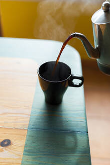Pouring coffee into a cup - JPTF00148