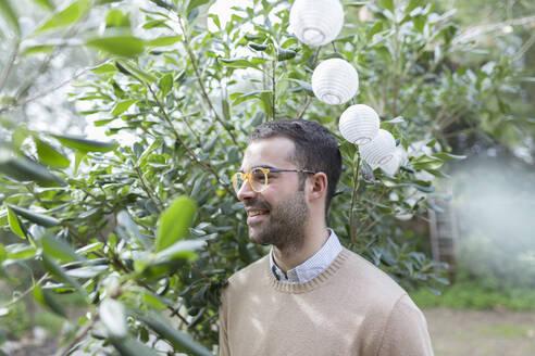 Smiling man in garden - JPTF00157