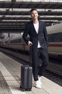 Mature man with trolley on station - PNEF01584