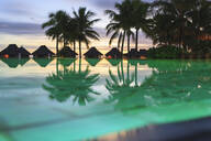 Palm trees and tropical resort, Bora Bora, French Polynesia - MINF12241