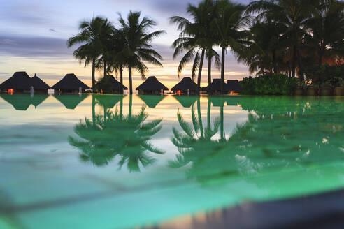 Palm trees and tropical resort, Bora Bora, French Polynesia - MINF12241