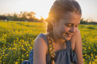 Caucasian girl smiling in field of flowers - BLEF06764