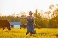 Caucasian girl running in field of flowers - BLEF06779