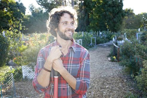 Caucasian man standing in garden - BLEF06809